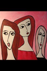 Tre damer ser sig omkring